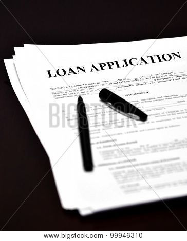 Loan document and agreement with pen for signing