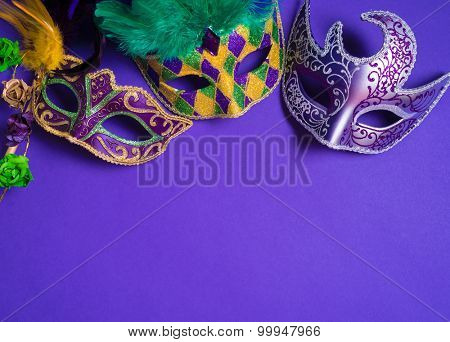 Mardi Gras or carnival mask on bright purple background