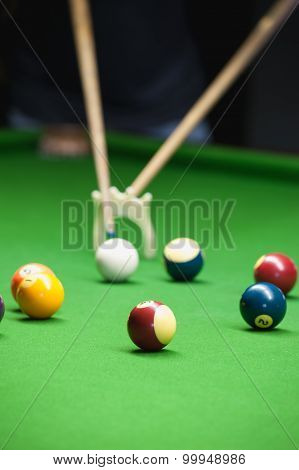 Snooker Player Placing The Cue Ball For A Shot