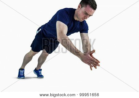 A fit man doing clapping hands push ups on a white background