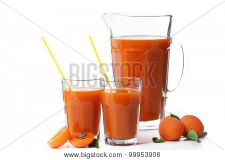 Glasses of apricots juice isolated on white