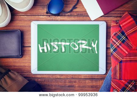 The word history and differents objects using every days against green