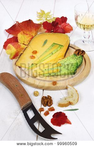 Cheese Platter: Solid Cheese, Autumn Leaves And Wineglass