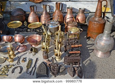 Antique implements utensils on the counter of flea market in Tbilisi. Georgia