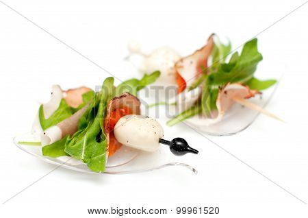 Stand-up snack canape with bacon and mozzarella