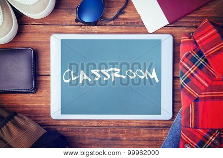 The word classroom and differents objects using every days against blue