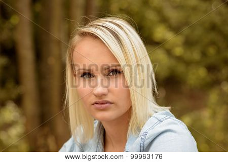 Pretty Blond Woman With A Serious Expression