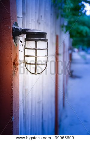 Outdoor Wall Lamp On Bamboo Fence
