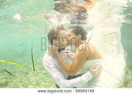 Bride And Groom Kissing Underwater