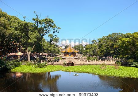 Pond And Pavilion Outside Puji Temple On The Buddhist Island Of Putuoshan, China