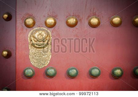 Red Wooden Door With Golden Lion Figure At The Forbidden City, Beijing