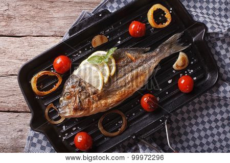 Dorado Fish Cooking On The Grill Pan Close-up. Horizontal  Top View