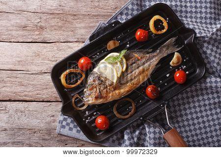 Dorado Fish Cooking On The Grill Pan. Horizontal Top View