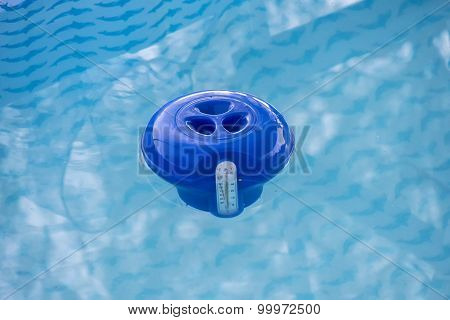 Blue Pool Chlorine Dispenser In The Water
