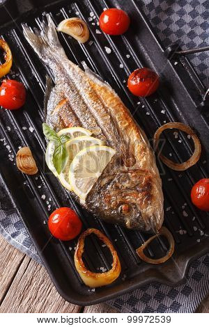 Dorado Fish With Vegetables Closeup On The Grill Pan. Vertical Top View