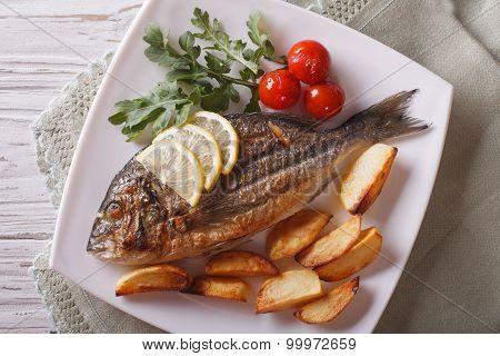 Grilled Dorado Fish With Fried Potatoes Closeup. Horizontal Top View