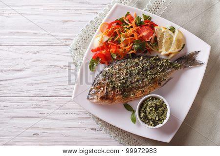 Grilled Dorado Fish With Pesto And Vegetable Salad. Horizonta Top View