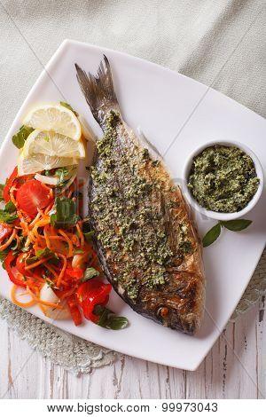 Grilled Dorado Fish With Pesto And Salad Closeup. Vertical Top View