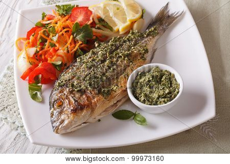 Grilled Dorado Fish With Pesto And Vegetable Salad. Horizontal