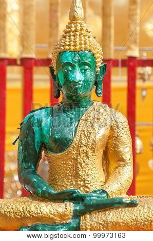 Green Buddha Statue Seated In The Lotus Position At Wat Phra That Doi Suthep, Chiang Mai, Thailand