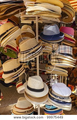 Summer Hats Hanging On A Hanger In The Store