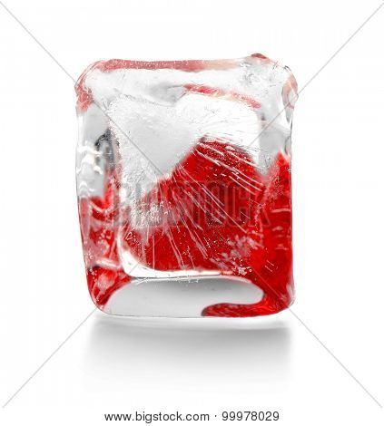 Red heart in ice cube isolated on white
