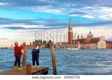 Gondolas at twilight in Venice lagoon, Italia