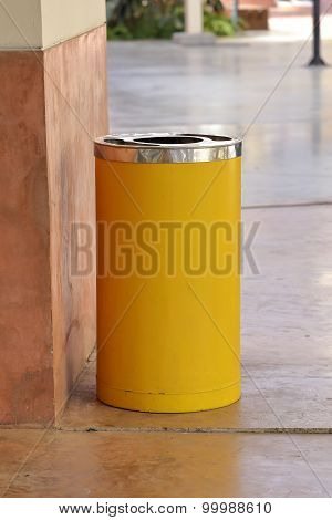 Yellow Metal Cylinder Bin