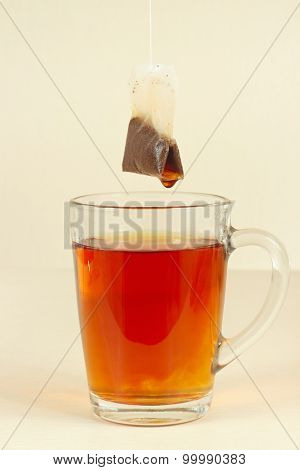 Tea bags over glass with fresh fragrant tea