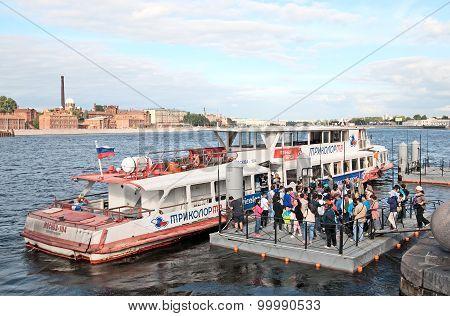 Saint-Petersburg. Russia. Chinese people near the Voskressenskaya Embankment