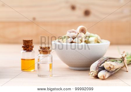 Natural Spa Ingredients Lemongrass Essential Oil  With Aromatherapy Burners On Wooden Background.