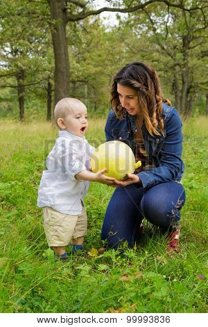 Mother And Child With Pumpkin