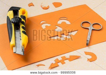 Making A Stencil Of Paper For Jack-o'-lantern