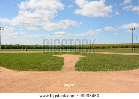 DYERSVILLE, IOWA - AUGUST 20, 2015: Field of Dreams movie set. Children and adults on the diamond of the 1989 movie set.