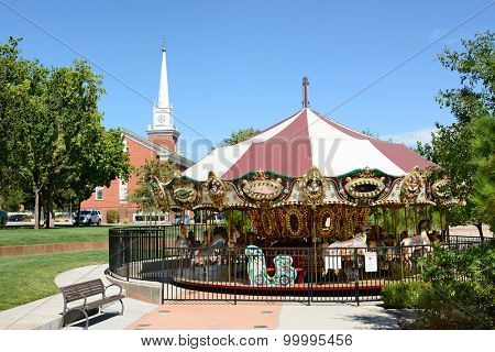 ST. GEORGE, UTAH - AUGUST 15, 2015: Town Square Carousel. The old fashioned ride, with the St George Tabernacle in the background, in in the towns historic district.
