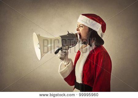 Female Santa Claus shouting into a megaphone