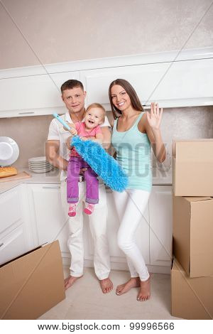 Cute friendly family is preparing to move in new building