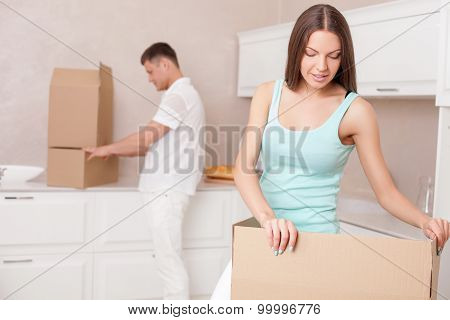 Cute husband and wife are moving in another building