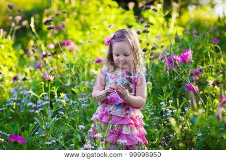 Little Girl In Flower Garden