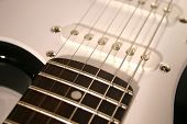 stock photo of stratocaster  - close up electric guitar stratocaster pickups strings - JPG