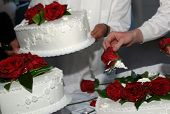 Arranging Flowers On Wedding Cake